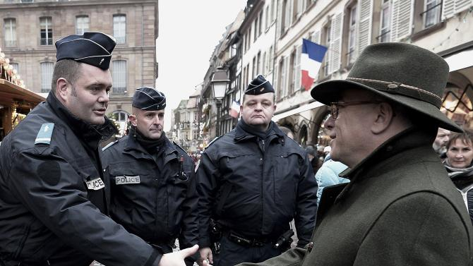 French Interior Minister Bernard Cazeneuve greets police officers during a visit to the traditional Christmas market in Strasbourg