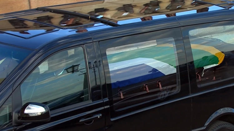 Still image from SABC video shows Mandla Mandela sitting in the front of the hearse carrying the coffin of his grandfather Nelson Mandela in Pretoria