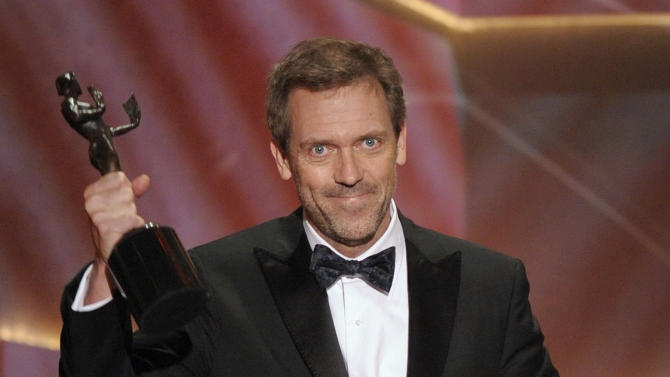 "FILE - In this Jan. 25, 2009 file photo, actor Hugh Laurie accepts the award for outstanding performance by a male actor in a drama series for ""House"" at the 15th Annual Screen Actors Guild  in Los Angeles.  The Fox medical drama concludes its eight-season run on Monday, May 21, 2012, with a finale at 9 p.m. EDT, preceded by a one-hour retrospective. (AP Photo/Mark J. Terrill, file)"