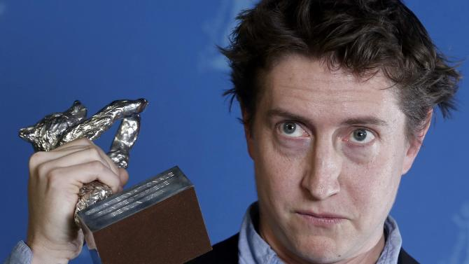 """Director David Gordon Green poses backstage with his Silver Bear award for Best Director for the movie """"Prince Avalanche"""" during the awards ceremony at the 63rd Berlinale International Film Festival in Berlin Saturday, Feb. 16, 2013. (AP Photo/Thomas Peter, pool)"""