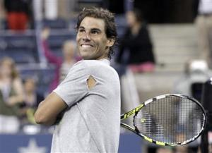 Rafael Nadal of Spain hits tennis balls into the crowd after defeating Rogerio Dutra Silva of Brazil at the U.S. Open tennis championships in New York