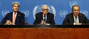 U.S. Secretary of State Kerry sits with Russian Foreign Minister Lavrov and UN Special Representative Lakhdar Brahimi in Geneva
