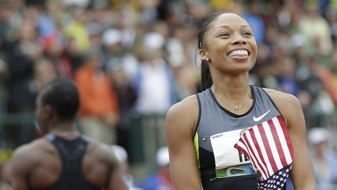 Allyson Felix, right, celebrates her win in the women's 200 meters at the U.S. Olympic Track and Field Trials Saturday, June 30, 2012, in Eugene, Ore. Felix won the 200 but she and Jeneba Tarmoh, walking off at left rear, tied for third place in the 100 meters. (AP Photo/Marcio Jose Sanchez)