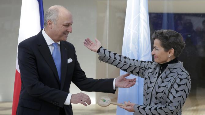 French Foreign Affairs Minister Laurent Fabius (L), President-designate of COP 21, and Christiana Figueres, Executive Secretary of the UN Framework Convention on Climate Change, attend a symbolic key handover ceremony at Le Bourget, near Paris