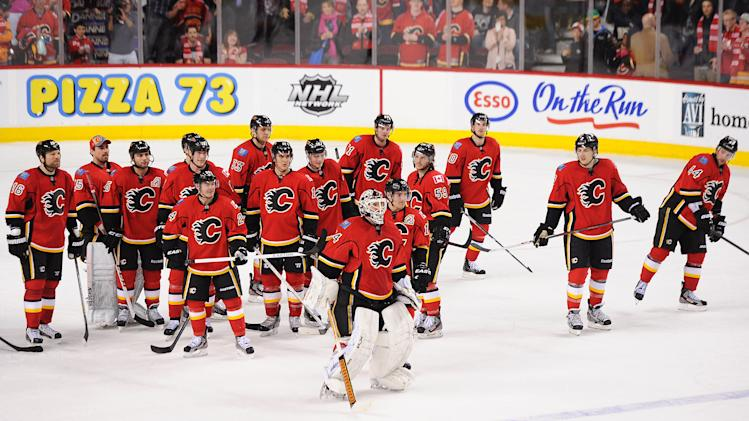 CALGARY, CANADA - APRIL 19: Members of the Calgary Flames line up after their final home game after defeating the Anaheim Ducks during an NHL game at Scotiabank Saddledome on April 19, 2013 in Calgary, Alberta, Canada. (Photo by Derek Leung/Getty Images)
