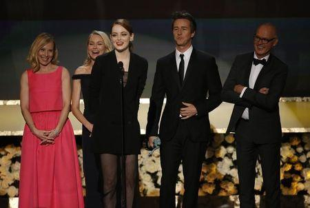 "Actress Emma Stone from the film ""Birdman"" accepts the award for Outstanding Performance by a Cast in a Motion Picture as co-stars Amy Ryan, Naomi Watts, Edward Norton and Michael Keaton listen at the 21st annual Screen Actors Guild Awards in Los Angeles"