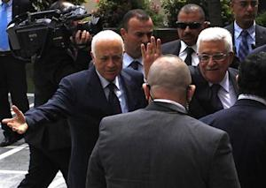 Arabi greets Abbas before attending an Arab Foreign Ministers' meeting in Cairo