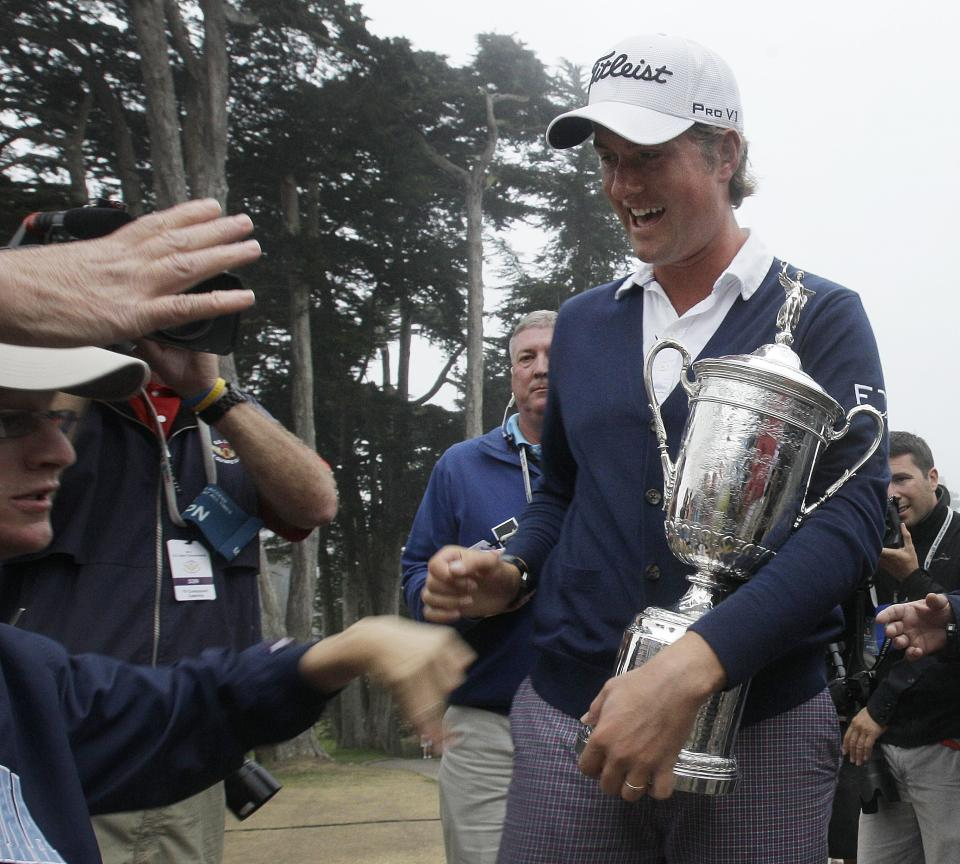 Webb Simpson smiles as he holds the championship trophy after the U.S. Open Championship golf tournament Sunday, June 17, 2012, at The Olympic Club in San Francisco. (AP Photo/Charlie Riedel)