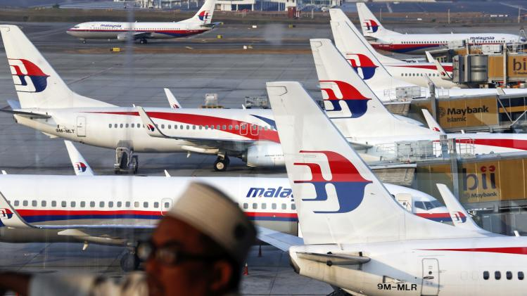 Malaysia Airlines planes are seen on the tarmac at the Kuala Lumpur International Airport