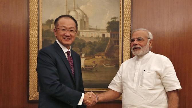 World Bank President Jim Young Kim (L) shakes hands with Indian Prime Minister Narendra Modi before their meeting in New Delhi on July 23, 2014