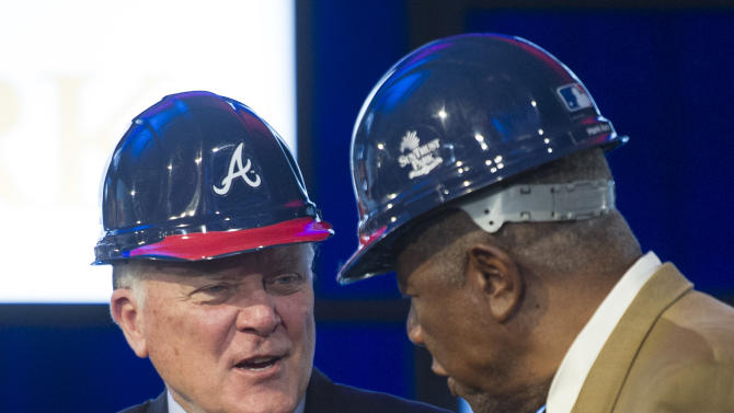 Georgia Gov. Nathan Deal, left, and baseball Hall of Famer Hank Aaron shake hands during a groundbreaking ceremony Tuesday, Sept. 16, 2014, in Atlanta, for the Atlanta Braves new baseball stadium, which will be called SuntTust Park. The Braves will be moving from Turner Field in Fulton County to the new stadium being built in Cobb County in 2017. (AP Photo/John Amis)