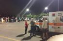 Emergency personnel stand by as evacuees gather at the Foothills Mall early Thursday, July 2, 2015, in Maryville, Tenn., after they were forced to leave their homes when rail car carrying a flammable and toxic gas has derailed and caught fire. (Brittany Bade/WBIR.com via AP)