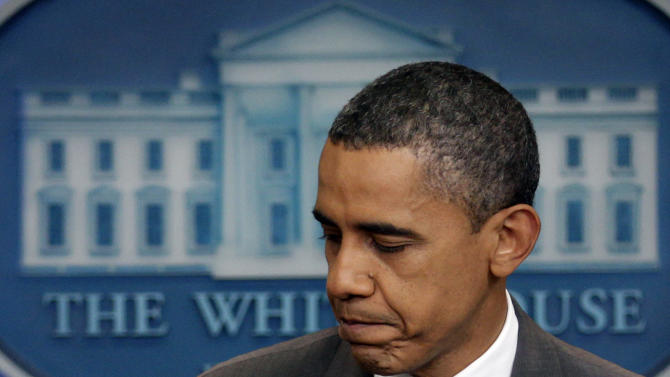 President Barack Obama turns to leave after speaking from White House briefing room, Sunday, July 31, 2011 in Washington, about a deal being reached to raise the debt limit.  (AP Photo/Carolyn Kaster)