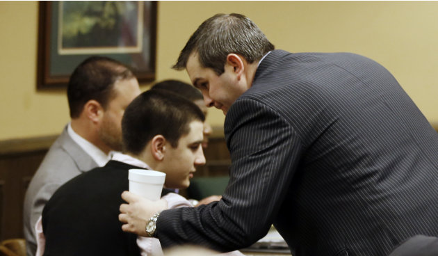 Trent Mays, 17, left, talks with one of his defense lawyers, Brian Duncan before the start for the fourth day of his and co-defendant 16-year-old Ma'lik Richmond's trial on rape charges in juvenile co