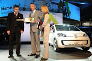 <p>Chairman of Volkswagen Slovakia Andreas Tostmann (centre) gives a symbolic key to then Slovak Prime Minister Robert Fico in front of a new Volkswagen UP! at the Volkswagen plant in Bratislava in 2009.</p>