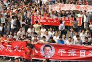 This file picture taken on September 18, shows anti-Japan protesters marching during a protest over the Diaoyu islands issue, known as the Senkaku islands in Japan, in the southern Chinese city of Shenzhen. Japanese businesses have taken a hit from a flare-up in the row between Tokyo and Beijing over the ownership of the islands