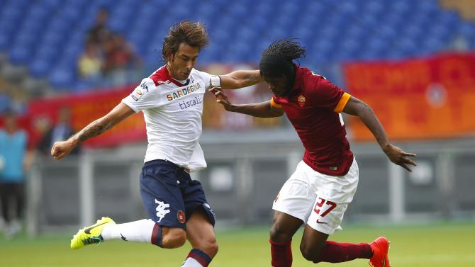 AS Roma's Gervinho is challenged by Cagliari's Daniele Conti during their Italian Serie A soccer match at the Olympic stadium in Rome