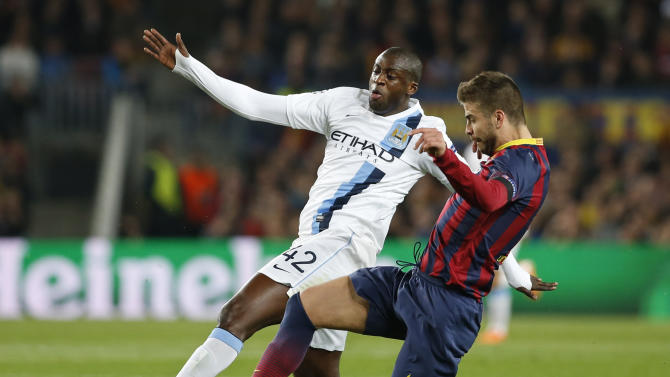 Manchester City's Yaya Toure, left is tackled by Barcelona's Gerard Pique during a Champions League, round of 16, second leg, soccer match between FC Barcelona and Manchester City at the Camp Nou Stadium in Barcelona, Spain, Wednesday March 12, 2014. (AP Photo/Emilio Morenatti)