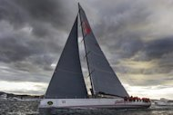 This photo, taken on December 28, 2012 and released by Rolex, shows supermaxi Wild Oats XI arriving in Hobart to complete the Rolex Sydney to Hobart Yacht Race. Wild Oats XI smashed her own record time in taking line honours ahead of Ragamuffin-Loyal in the gruelling race