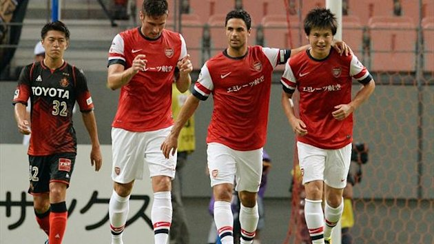 Arsenal FC forward Ryo Miyauchi (R) is celebrated his score by teammates during their friendly match against Nagoya Grampus in Toyota, Aichi prefecture on July 22, 2013 (AFP)