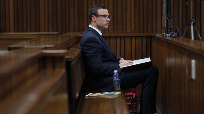 "Oscar Pistorius sits in the courtroom during day 37 of his trial in Pretoria, South Africa, Thursday, July 3, 2014. Pistorius is a ""paradox"" whose past triumphs as a sprinter crossing the finish line with raised arms contrasted sharply with the daily, severe limitations that he endured because of his disability, a physician testified Thursday at the runner's murder trial. (AP Photo/Jerome Delay, Pool)"