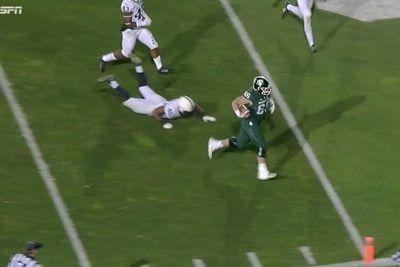 Michigan State's 296-pound center took a handoff and stiffarmed a defender like that's his job