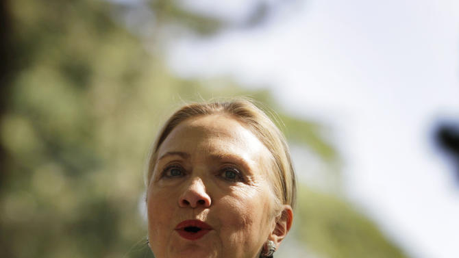 """U.S. Secretary of State Hillary Rodham Clinton speaks during a joint press conference with Afghan President Hamid Karzai, not pictured, at the Presidential Palace in Kabul, Afghanistan, Saturday, July 7, 2012. Clinton announced that President Barack Obama had designated Afghanistan as a """"major non-NATO ally"""" shortly after arriving in the country for talks with Karzai. (AP Photo/Ahmad Jamshid)"""