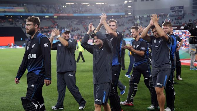 New Zealand players thank their fans after their victory in the semi-final Cricket World Cup match between New Zealand and South Africa in Auckland on March 24, 2015