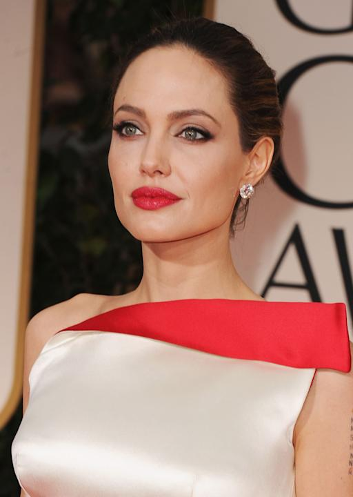 HIT: Love her or hate her, Angelina is pure perfection. My only question is why doesn't she wear a red lip every single day?! So. Gorgeous. And her skin is FLAWLESS. (Steve Granitz/WireImage)