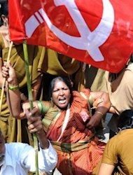 Activists from opposition parties protest in Hyderabad. Opposition parties and trade unions called a strike after Prime Minister Manmohan Singh last week announced a raft of reforms designed to revive India&#39;s slowing economy, a move that has sparked a furious backlash