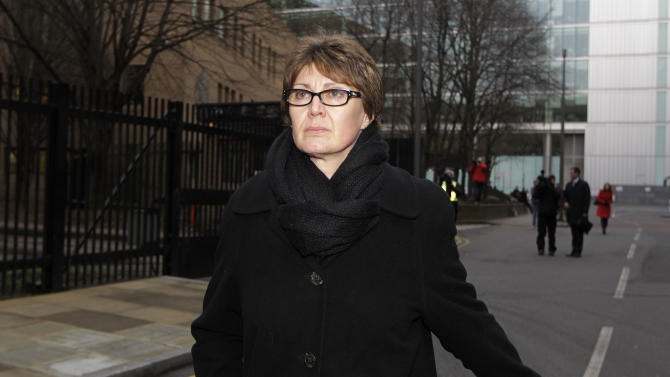 FILE - In this Thursday, Jan. 10, 2013 file photo Detective Chief Inspector April Casburn of the London Metropolitan Police leaves Southwark Crown Court in London. A senior British counterterrorism detective was sentenced Friday Jan. 1, 2013 to 15 months in prison for trying to sell information to Rupert Murdoch's News of the World tabloid. Detective Chief Inspector April Casburn, 53, was the first person convicted on charges related to Britain's phone-hacking scandal since a police investigation was reopened in early 2011. (AP Photo/Sang Tan, File)