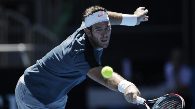 Argentina's Juan Martin Del Potro reaches for a backhand return to France's Jeremy Chardy during their third round match at the Australian Open tennis championship in Melbourne, Australia, Saturday, Jan. 19, 2013. (AP Photo/Rob Griffith)