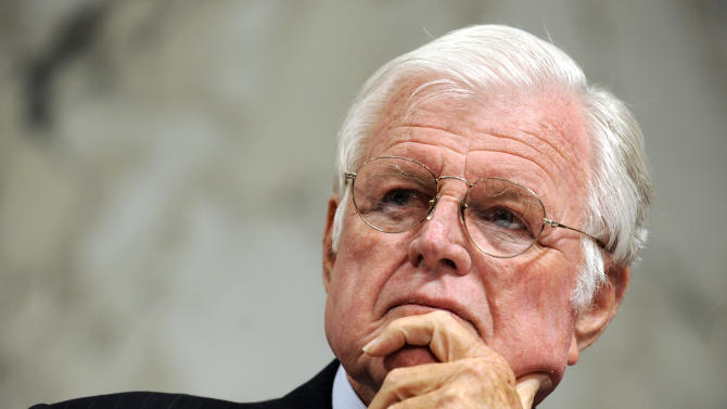 FILE - In this March 31, 2009 file photo, Sen. Edward Kennedy, D-Mass., listens on Capitol Hill in Washington. An FBI file contends that a young Edward Kennedy arranged to rent a brothel for a night while visiting Chile in 1961, a year before he was elected to the Senate.  (AP Photo/Susan Walsh, File)