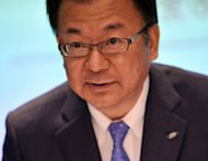 Japan&#39;s electronics company Sharp President Takashi Okuda, seen during a press conference in Tokyo, on August 2. He said Sharp would cut 5,000 jobs by March 2013 as the company reported a quarterly loss and said it would remain in the red for the rest of the year amid losses at its struggling TV business
