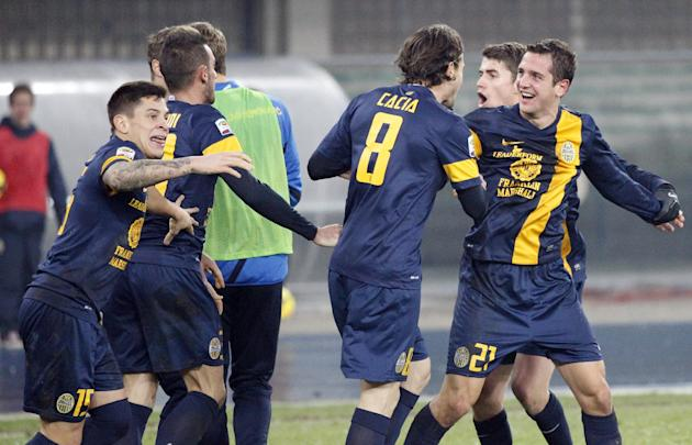 Hellas Verona's forward Juanito, right, of Argentina, right, celebrates with teammates after scoring during a Serie A soccer match against Atalanta at Bentegodi stadium in Verona, Italy, Sunday, D