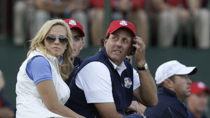 USA's Phil Mickelson and wife Amy watch USA's Tiger Woods and Steve Stricker during a four-ball match at the Ryder Cup PGA golf tournament Friday, Sept. 28, 2012, at the Medinah Country Club in Medinah, Ill. (AP Photo/Chris Carlson)
