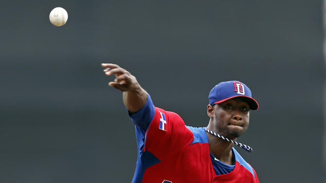 Dominican Republic starting pitcher Samuel Deduno throws in the first inning against Spain during a World Baseball Classic game in San Juan, Puerto Rico, Saturday, March 9, 2013. (AP Photo/Andres Leighton)