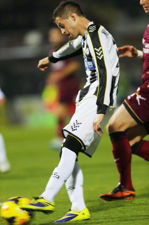 Udinese's Nicolas Lopez, of Uruguay, shoots to score during a Serie A soccer match between Livorno and Udinese, in Leghorn, Italy, Saturday, Dec. 21, 2013