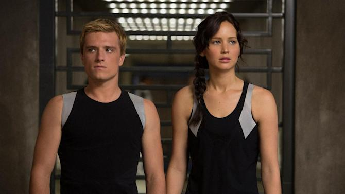 """This image released by Lionsgate shows Josh Hutcherson as Peeta Mellark, left, and Jennifer Lawrence as Katniss Everdeen in a scene from """"The Hunger Games: Catching Fire."""" The movie opens in theaters Friday, Nov. 22, 2013, in what's expected to be one of the year's biggest box-office debuts. (AP Photo/Lionsgate, Murray Close)"""