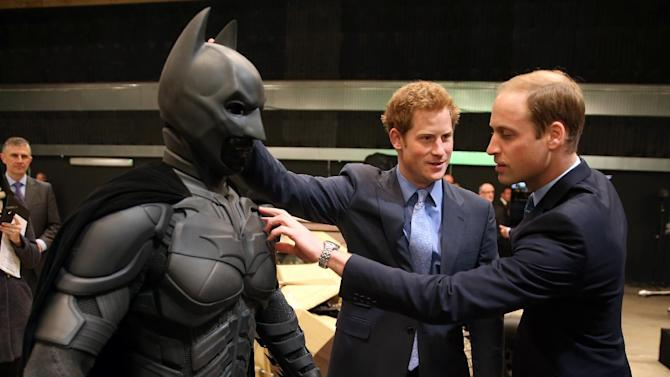 "Britain's Prince William, right, and his brother Prince Harry look at a 'Batsuit' used in the Batman films as they and Kate the Duchess of Cambridge, not pictured, attend the inauguration of ""Warner Bros. Studios Leavesden"" near Watford, approximately 18 miles north west of central London, Friday, April 26, 2013. As well as attending the inauguration Friday at the former World War II airfield site, the royals will undertake a tour of Warner Bros. ""Studio Tour London - The Making of Harry Potter"", where they will view props, costumes and models from the Harry Potter film series. (AP Photo/Chris Jackson, Pool)"