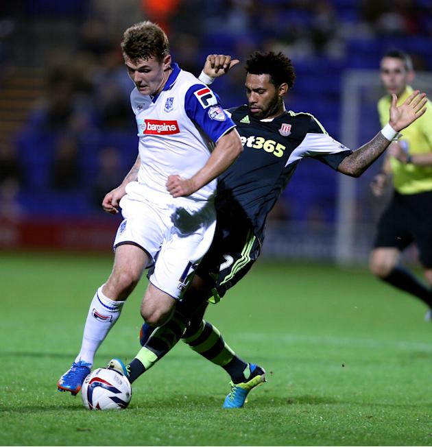 Tranmere Rovers Max Power, left, and Stoke City's Jermaine Pennant challenge for the ball during their League Cup, Third round match at Prenton Park, Tranmere, England, Wednesday Sept. 25, 2013