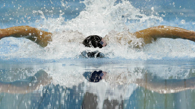 FILE - In this Thursday, Aug. 2, 2012 file photo, United States' Michael Phelps competes in the men's 100-meter butterfly swimming semifinal at the Aquatics Centre in the Olympic Park during the 2012 Summer Olympics in London. Phelps became the most decorated Olympian in history in 2012, adding to his enormous swimming haul with six more medals at the London Games, where the United States topped the winning charts once again. (AP Photo/Michael Sohn, File)