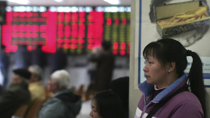 An investor looks at the stock price monitor at a private securities company Monday, March 12, 2012 in Shanghai, China. Asian stock markets fell Monday after China's trade figures underlined a slowdown in the world's No. 2 economy. (AP Photo)