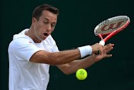 Czech Republic&#39;s Lukas Rosol plays a backhand shot during his third round men&#39;s singles defeat to Germany&#39;s Philipp Kohlschreiber at the All England Tennis Club in Wimbledon, southwest London