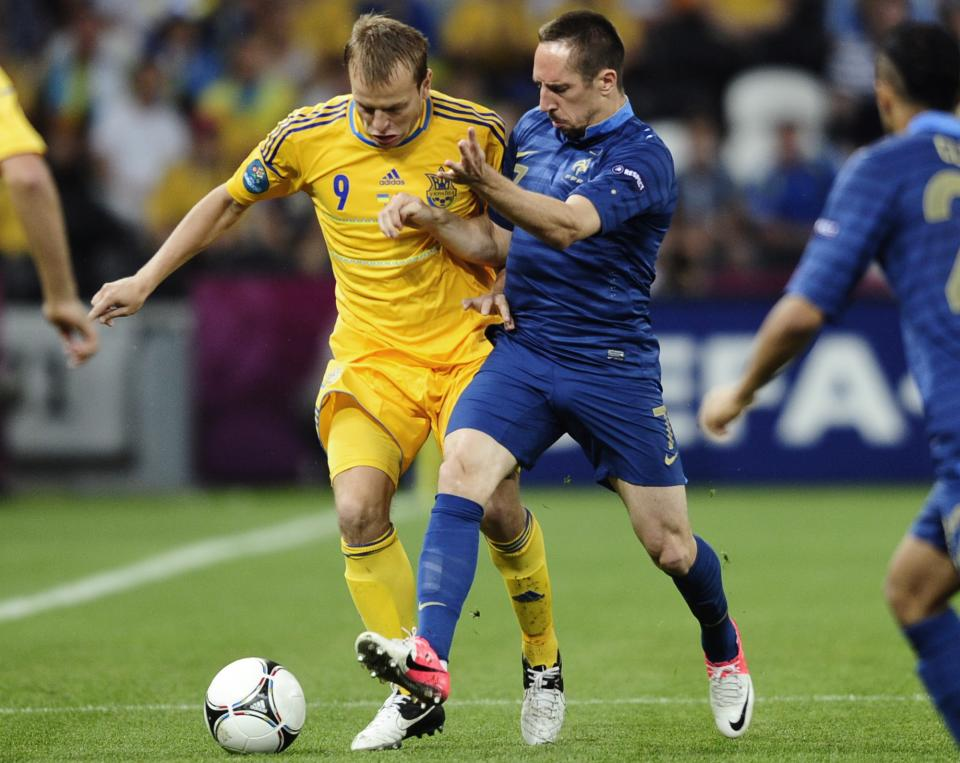 France's Franck Ribery, right, and Ukraine's Oleh Gusev challenge for the ball during the Euro 2012 soccer championship Group D match between Ukraine and France in Donetsk, Ukraine, Friday, June 15, 2012. (AP Photo/Manu Fernandez)