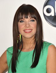 FILE - In this May 20, 2012 file photo, singer Carly Rae Jepsen poses for a photo in the media room at the 2012 Billboard Awards at the MGM Grand in Las Vegas. For those predicting that Jepsen might be headed to one-hit wonder-dom, take note _ she&#39;s already got another song climbing the charts, &quot;Good Time,&quot; with Owl City. Still, it&#39;s her ubiquitous &quot;Call Me Maybe&quot; that has shot her to stardom and taken the world by storm. The song has been No. 1 on Billboard&#39;s Hot 100 chart for the last five weeks, and parodies of the song from the likes of Justin Bieber and boy band Big Time Rush to James Franco and even Cookie Monster have popped up online and on late night talk shows. (Photo by John Shearer/Invision/AP, File)