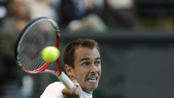 Lukas Rosol of the Czech Republic plays a return to Rafael Nadal of Spain during a second round men's singles match at the All England Lawn Tennis Championships at Wimbledon, England, Thursday, June 28, 2012. (AP Photo/Anja Niedringhaus)