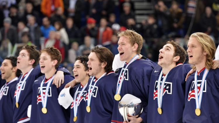 Team USA players sing their national anthem after defeating Sweden during third period gold medal hockey action at the IIHF World Junior Championships in Ufa, Russia, on Saturday, Jan. 5, 2013. (AP Photo/The Canadian Press, Nathan Denette)