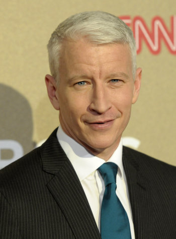 FILE - In this Sunday, Dec. 2, 2012 file photo, reporter Anderson Cooper arrives at CNN Heroes at The Shrine Auditorium in Los Angeles. Cooper says a reporting assignment turned into a temporary blindness scare. On his talk show Tuesday, Dec. 4, Cooper said he was in Portugal last week working on a story for &quot;60 Minutes,&quot; spent two hours on the water and then suffered a 36-hour loss of sight. (Photo by Dan Steinberg/Invision/AP, File)