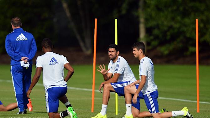 Chelsea's Spanish striker Diego Costa (2R) stretches during a training session at Chelsea's training ground in Stoke D'Abernon,  on July 31, 2015